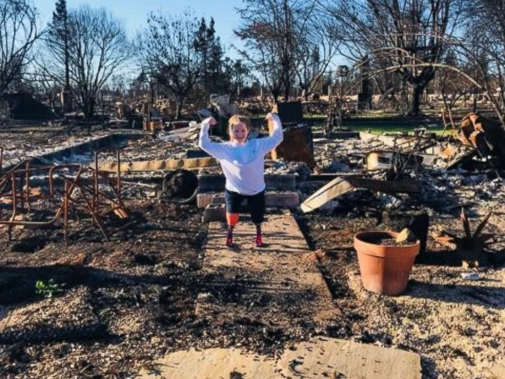PHOTO: Lily Biagini, 10, stands on the remains of her familys home in Santa Rosa, Calif.