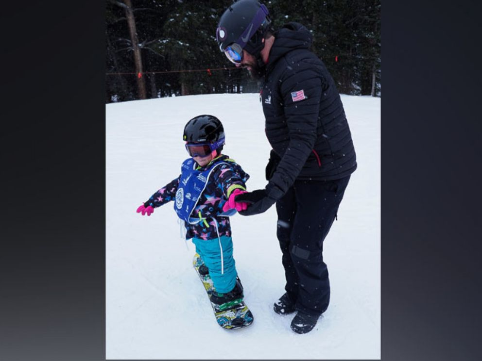 PHOTO: Lilly Biagini, 10, snowboards in Breckenridge, Colorado, with Keith Gabel, a U.S. Paralympian and bronze medalist in snowboarding.