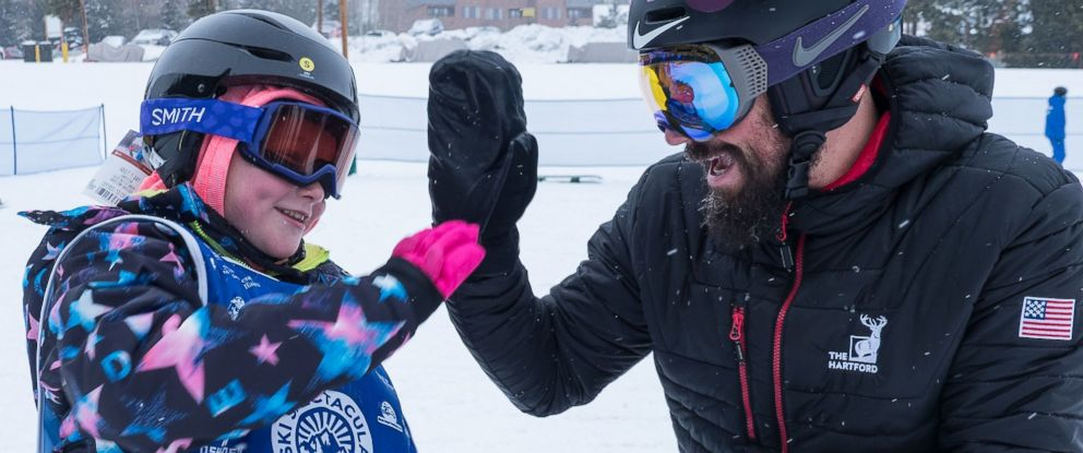 PHOTO: Lilly Biagini, 10, gives Keith Gabel, a U.S. Paralympian, a high five.