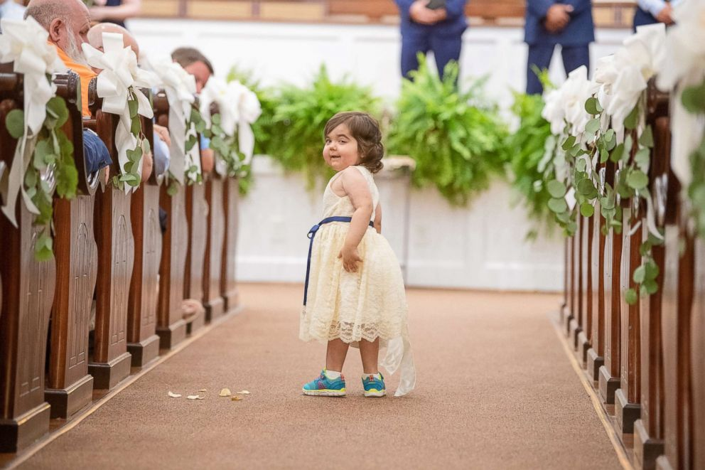 PHOTO: Skye Savren-McCormick, 3, walks down the aisle as the flower girl for her bone marrow donors wedding on June 9, 2018.