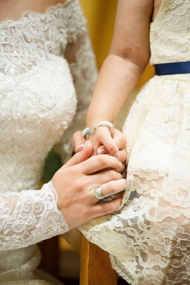 PHOTO: Skye Savren-McCormick holds hand with her bone marrow donor, Hayden Hatfield Ryals on her wedding day, June 9, 2018.