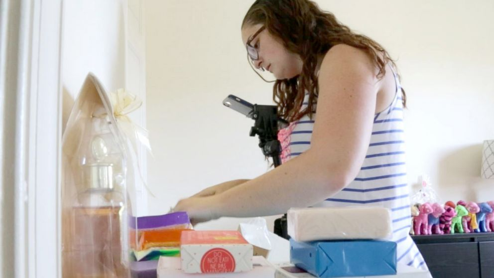 Kaelin Brady cuts up bars of soap for her thousands of Instagram followers from her home in Frederick, Maryland.