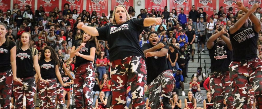 PHOTO: Lake Mary High School principal Dr. Mickey Reynolds performs with the schools step team at their pep rally on Nov. 3, 2017.