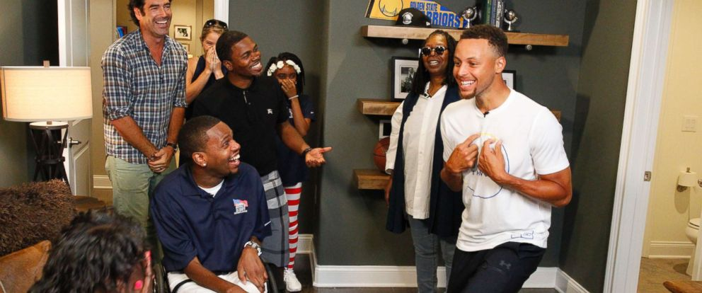 PHOTO: Golden State Warriors superstar Stephen Curry surprised Navy vet Timothy Birckhead at the unveiling of Birckheads new, specially-adapted home.