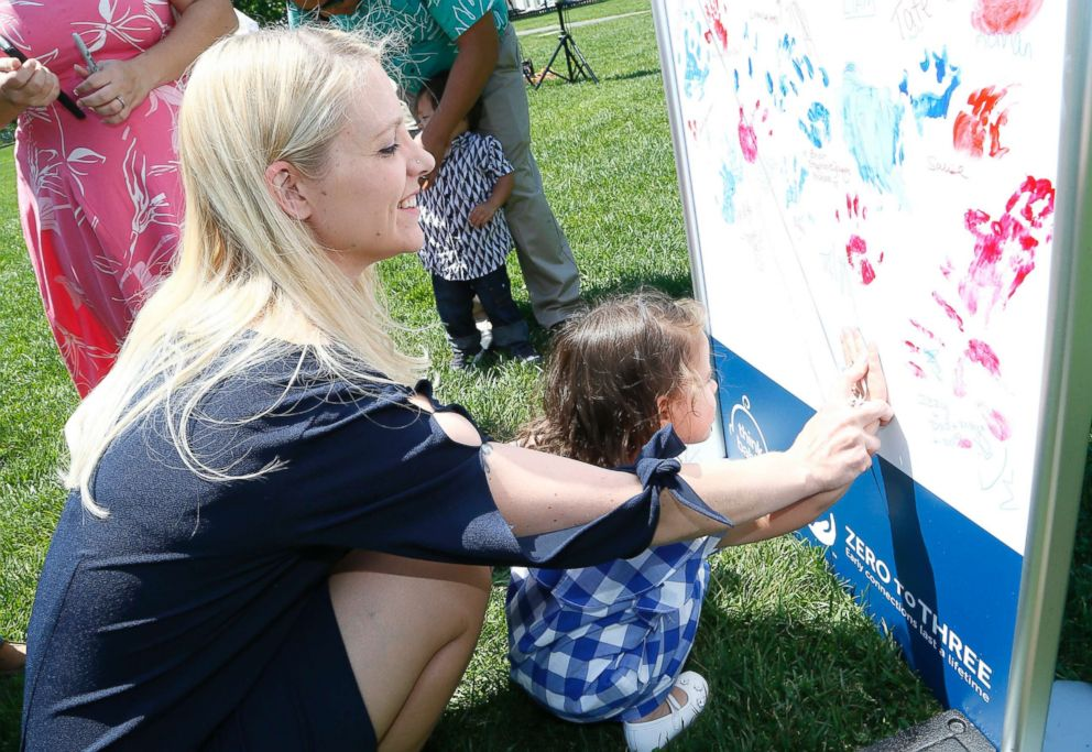 PHOTO: Tracey Pontani, left, and her daughter use fingerpaint to sign a petition urging Congress to Think Babies during second annual Strolling Thunder event on the East lawn of the U.S. Capitol Building, May 8, 2018.