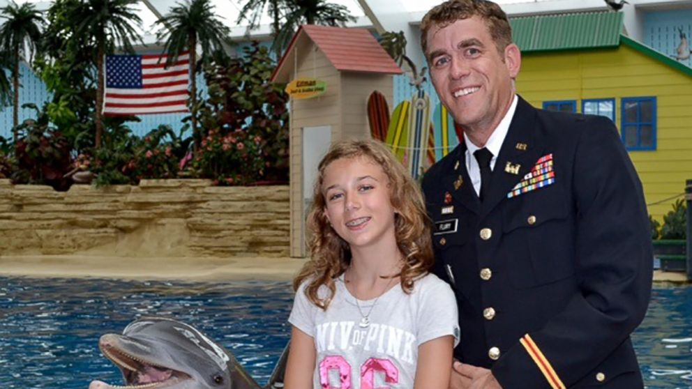 Capt. Josh Flury returned home from a 9-month deployment and surprised his 12-year-old daughter, Kristi, at Chicago's Brookfield Zoo.