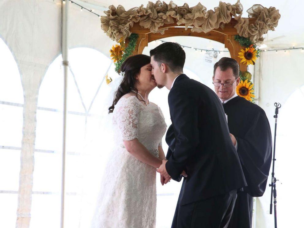PHOTO: Jennifer Jensen, 24, and Bill Jensen, 27, kiss after being married by Judge Chris Wilton.