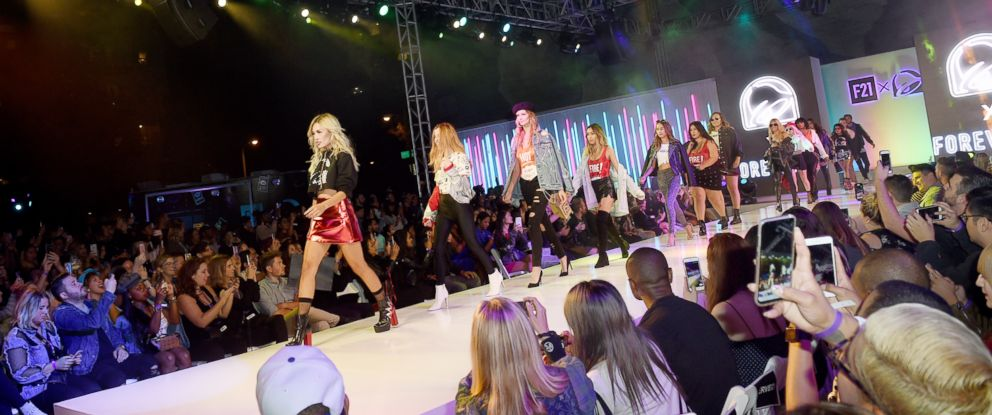 PHOTO: Super fans and influencers show off the Taco Bell clothing line at a runway show in Los Angeles, Oct. 10, 2017.