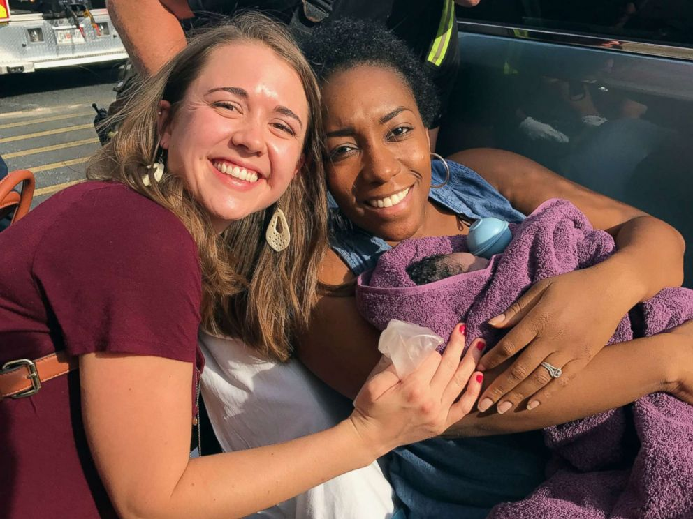 PHOTO: Caris Lockwood, 24, a labor nad delivery nurse from Atlanta, Georgia, delivered the baby boy of Tanya Saint Preux Picault on Aug. 25 outside the entrance of a Target store near the Mall of Georgia in Buford, Georgia.