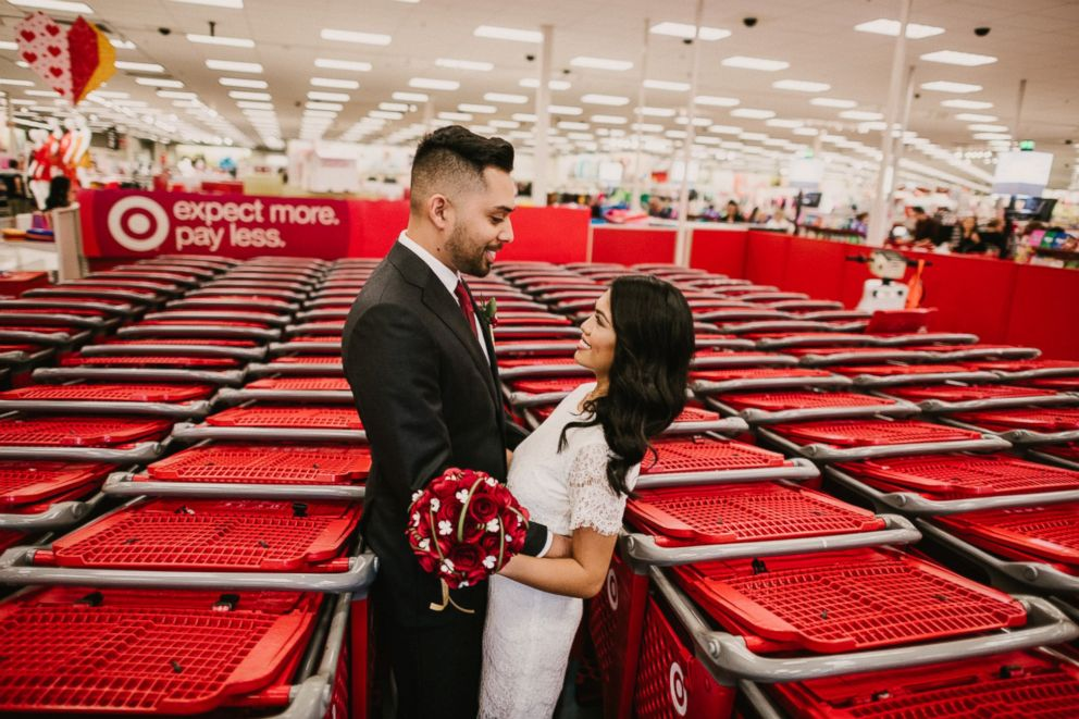 PHOTO: Newlyweds Michael Delvalle and Isabella Sablan pose among shopping carts inside a North Miami, Florida-area Target.