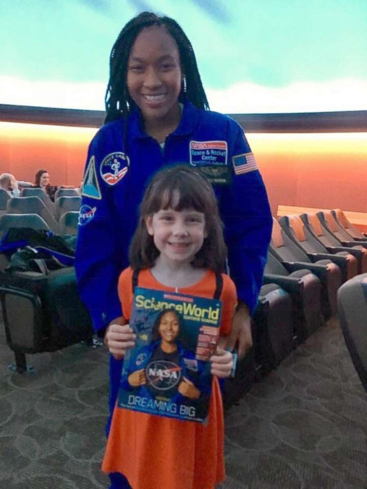 PHOTO: Taylor Richardson with a young fan holding the October issue of Scholastic Science World.