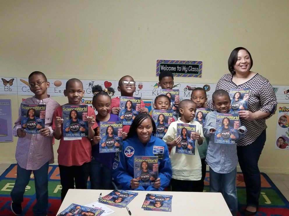 PHOTO: Taylor Richardson with a class of students holding the October issue of Scholastic Science World.