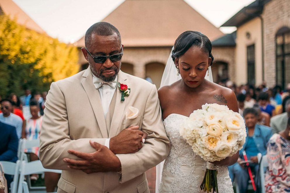 PHOTO: Tearra Suber and her father walk down the aisle on Sept. 4, 2016.