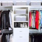 Clothes sorted by color hang in a closet organized by The Home Edit.