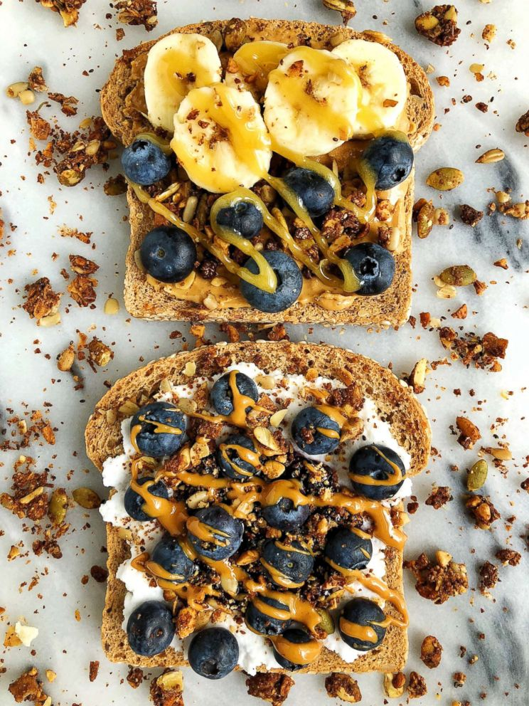 """Wellness blogger Rachel Mansfield says toast is the most underrated food to make an eat. This one with nut butter, banana and some crunchy granola on top is a """"game changer."""""""