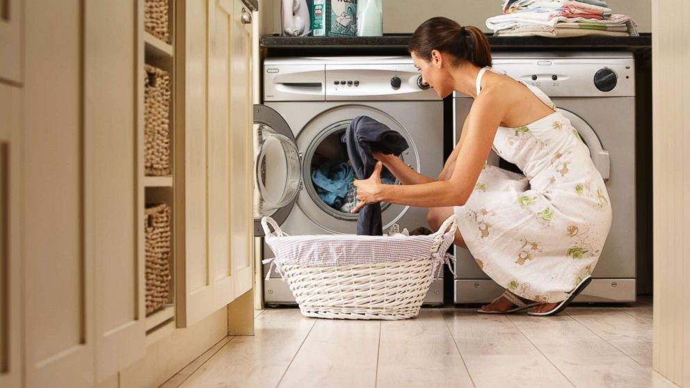 In this undated stock photo, a woman unloading a washing machine.