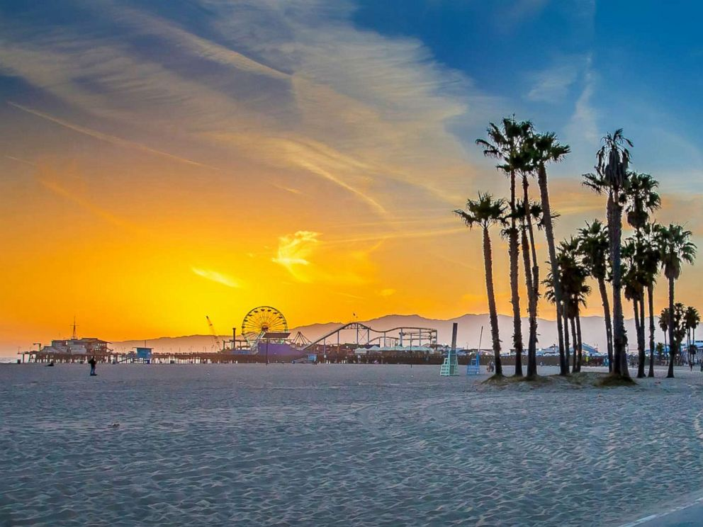 PHOTO: A vivid sunset is seen over Venice Beach with Santa Monica Pier in the distance in this undated stock photo.
