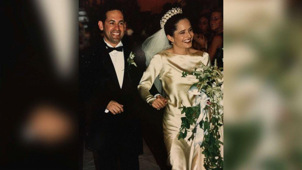 Elena Salinas and Ric Salinas walk down the aisle on their wedding day in 1997.