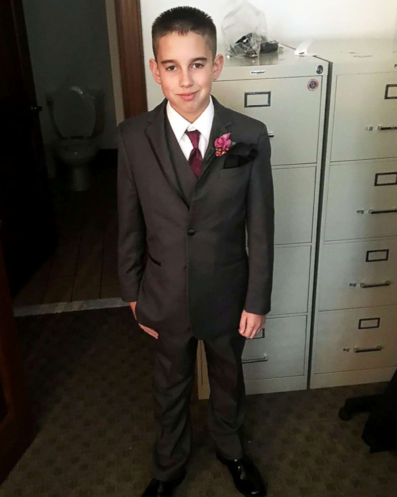 PHOTO: Jaydon Rabatin poses in his suit as the best man for his dads Nov. 12 wedding.