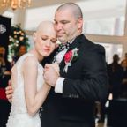 Newlyweds Laurin and Michael Bank enjoyed their first dance at their March 24 nuptials.