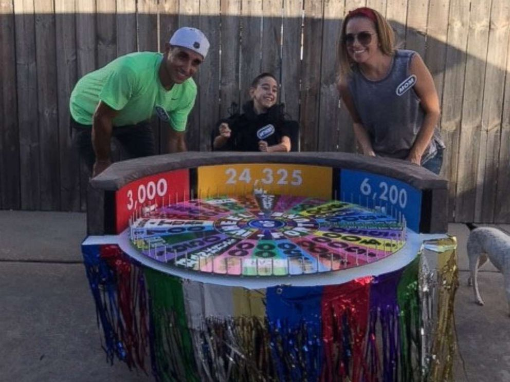 PHOTO: Anthony Alfano, 8, poses with his parents in his Wheel of Fortune Halloween costume.