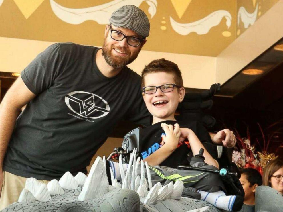 PHOTO: Magic Wheelchair founder Ryan Weimer poses with his eldest son, Keaton.
