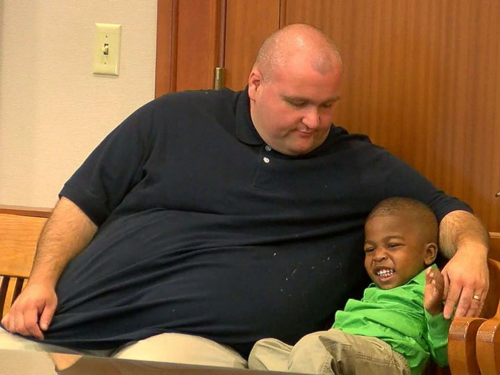 PHOTO: Will Rom and his son KJ Rom sit in Judge Ralph Winklers courtroom at Hamilton County Probate Court in Cincinnati, July 27, 20017, awaiting the adoption proceeding to begin.