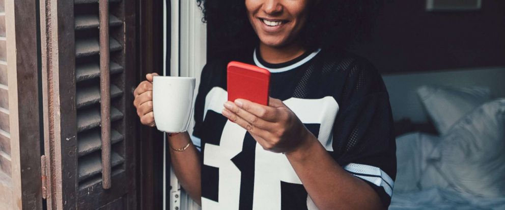 PHOTO: A young woman uses a smartphone in an undated stock photo.