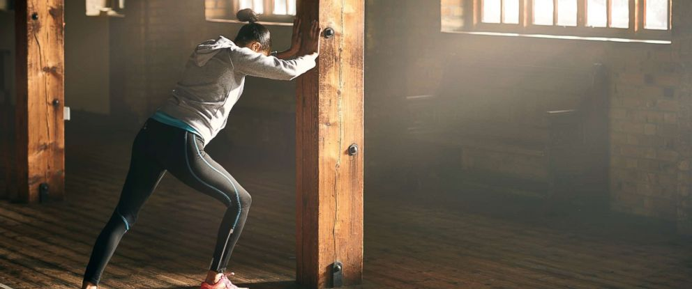 PHOTO: A woman stretches at a gym in this stock photo.