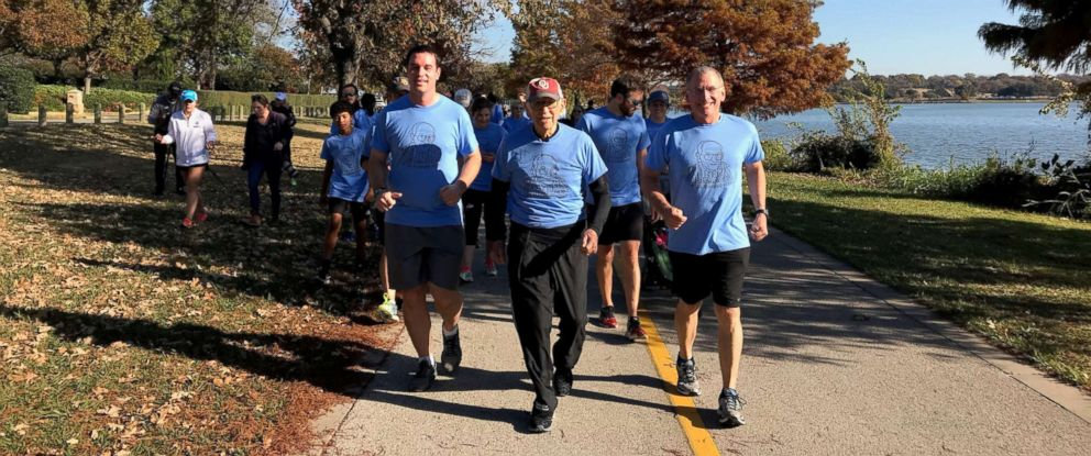 PHOTO: WWII veteran Orville Rogers leads his family by running cumulatively 100 miles around White Rock Lake in Dallas, Texas, last Saturday, to celebrate his 100th birthday.