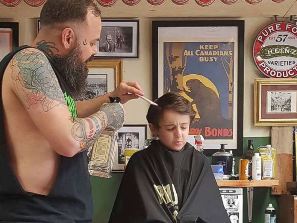 PHOTO: Franz Jakob, a barber in Rouyn-Noranda, Quebec, had to go onto the floor to cut Wyatt Lafreniere. The 6-year-old boy has autism with sensory issues.