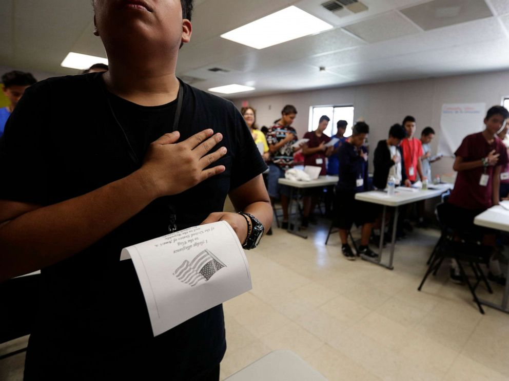 PHOTO: Immigrants say the Pledge of Allegiance in a writing class at the U.S. governments holding center for migrant children in Carrizo Springs, Texas, July 9, 2019.