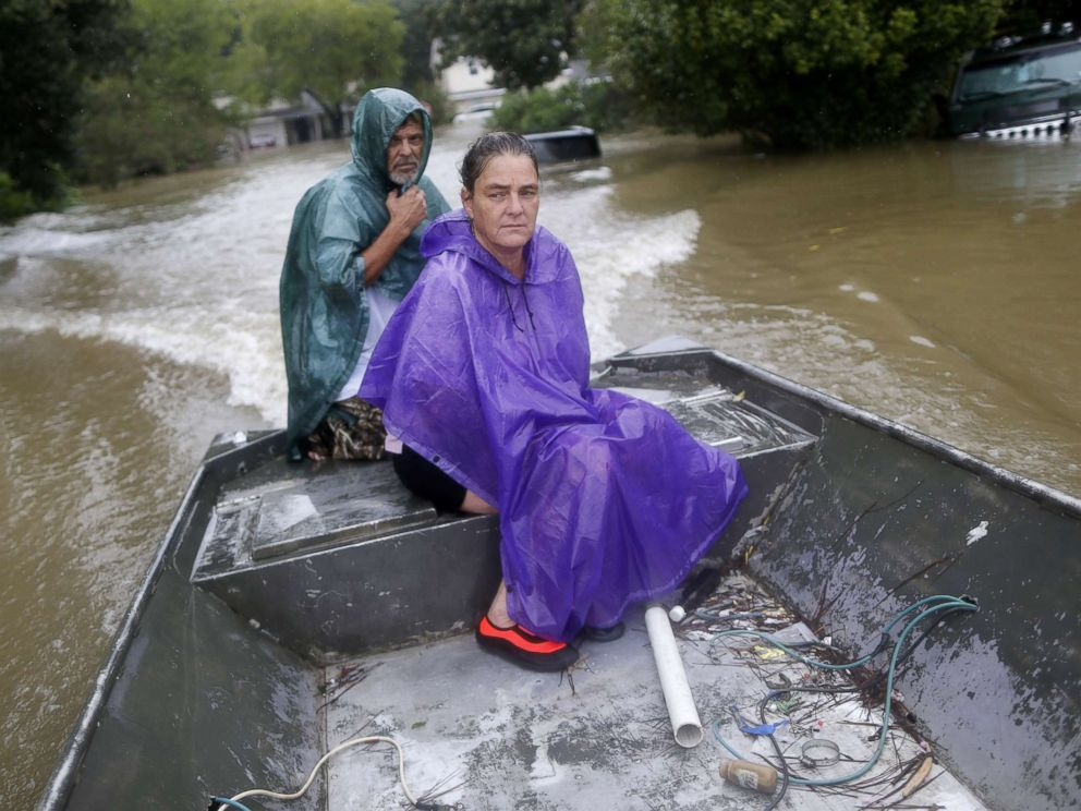 PHOTO: Curtis and Michelle Bertrand look for residents to rescue from the flood waters of Tropical Storm Harvey in Beaumont Place, Texas, on Aug. 28, 2017.