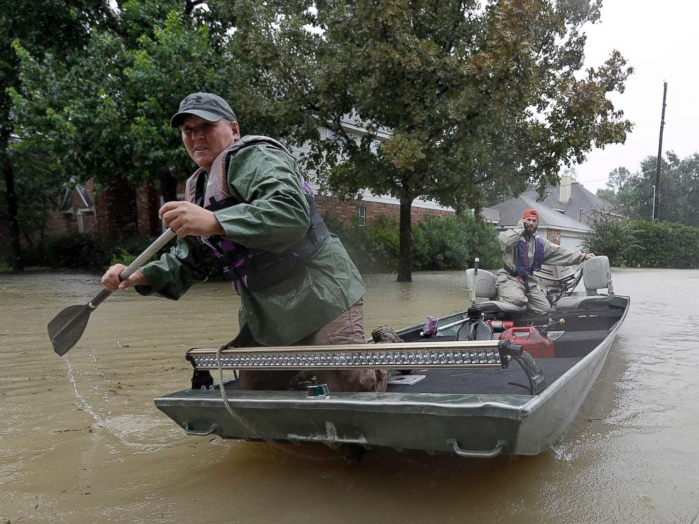 PHOTO: Volunteers use their boat to help evacuate residents as floodwaters from Tropical Storm Harvey rise Monday, Aug. 28, 2017, in Spring, Texas.