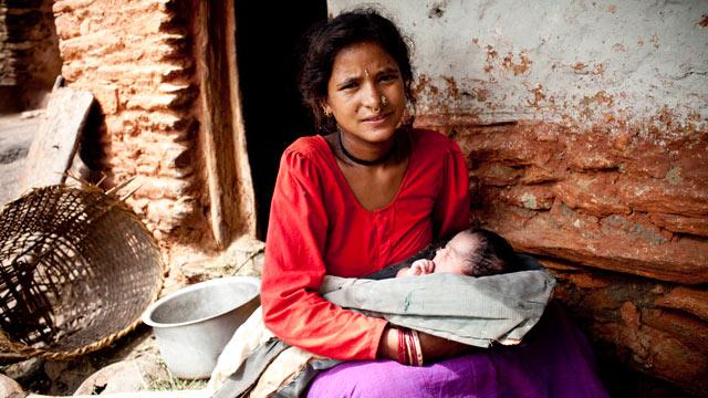 PHOTO:Maheshwori Devi Bishwokarma, 19, with her newborn daughter, Seema, in Dikha Village, Nepal.