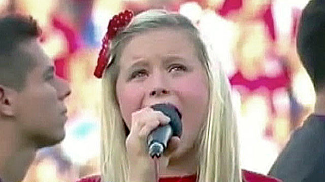 "PHOTO: Harper Gruzins, 11, sings ?The Star-Spangled Banner,"" at a major league soccer game in Dallas, Texas."