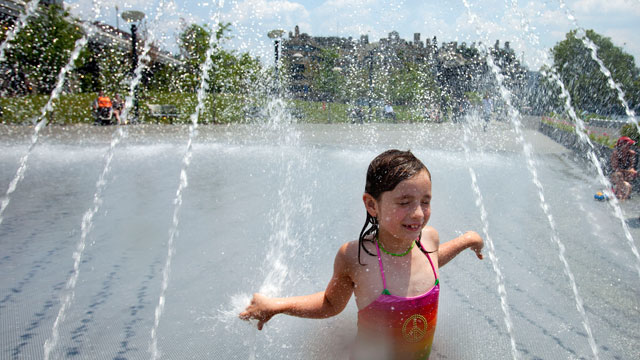 PHOTO: Sophia Tatton, 7, of Washington, cools off in the fountains at Georgetown Waterfront Park, in Washington, on Wednesday, June 20, 2012. Temperatures across the Northeast are expected to approach triple digits.