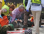 PHOTO: Emergency personnel respond to the scene after explosions went off near the finish line of the 117th Boston Marathon, April 15, 2013.