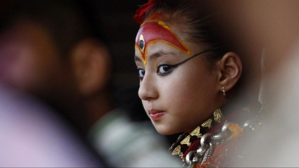 This 7 year old nepali girl is worshipped as a living goddess on buffering ccuart Images