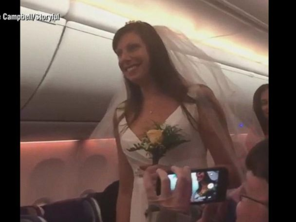 WATCH:  This couple got married on a plane mid-flight