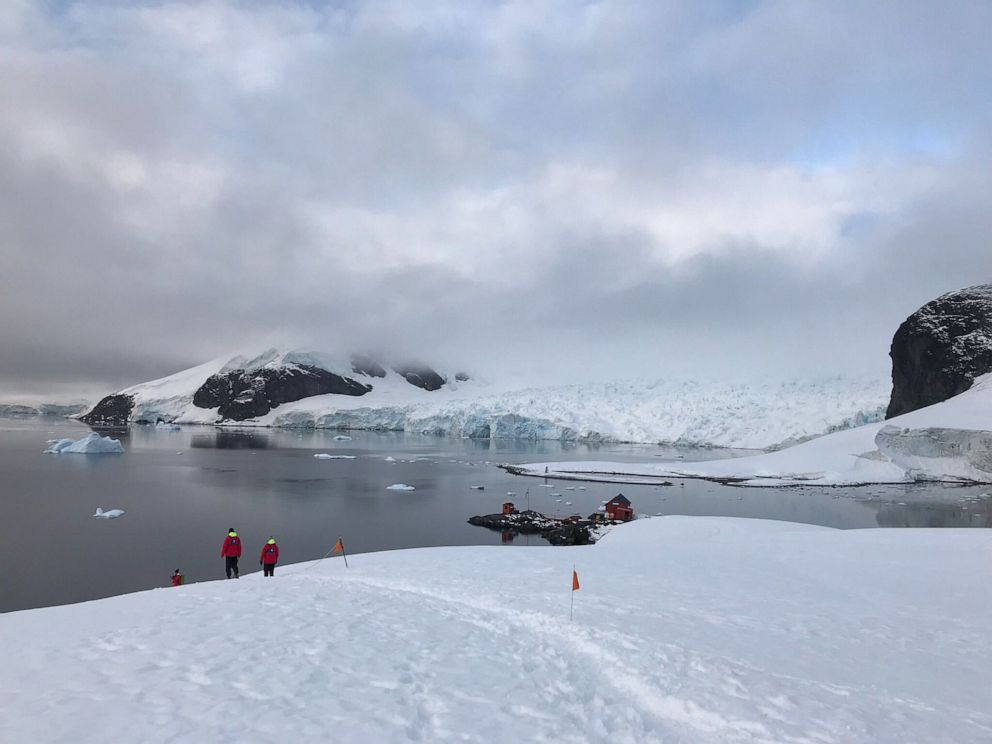 PHOTO: Scientists and researchers walk towards the shoreline in Antarctica.