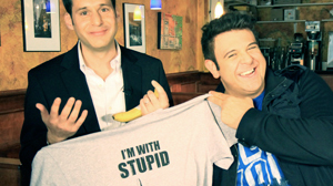 PHOTO ?Man v. Food? host Adam Richman, right, celebrates with John Berman after the ?Nightline? correspondent took the Stupid Wing Challenge.