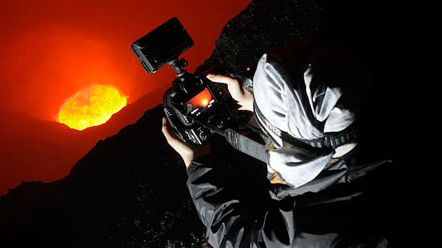 PHOTO: ABC News Asia Producer Karson Yiu lies right on the edge of Mt. Marums crater.