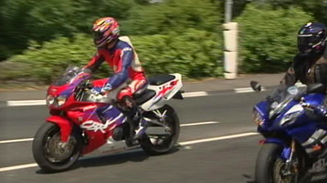 """PHOTO:ABCs Simon McGregor-Wood, in the red suit, took a ride on the Isle of Man TT race circuit on """"Mad Sunday,"""" June 5, 2011."""