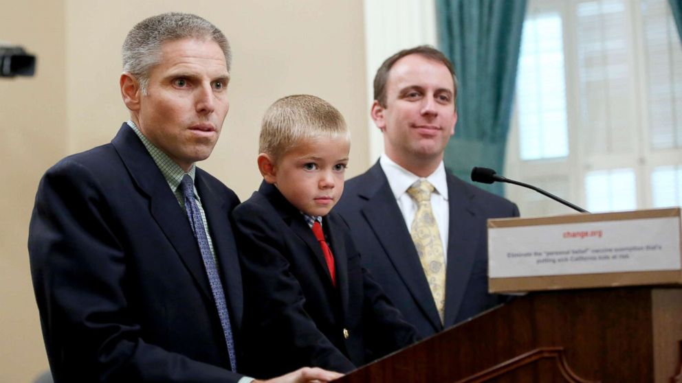 Carl Krawitt, left, a supporter of a measure requiring nearly all of California school children to be vaccinated, answers a question during a news conference at the Capitol in Sacramento, Calif., June 24, 2015.