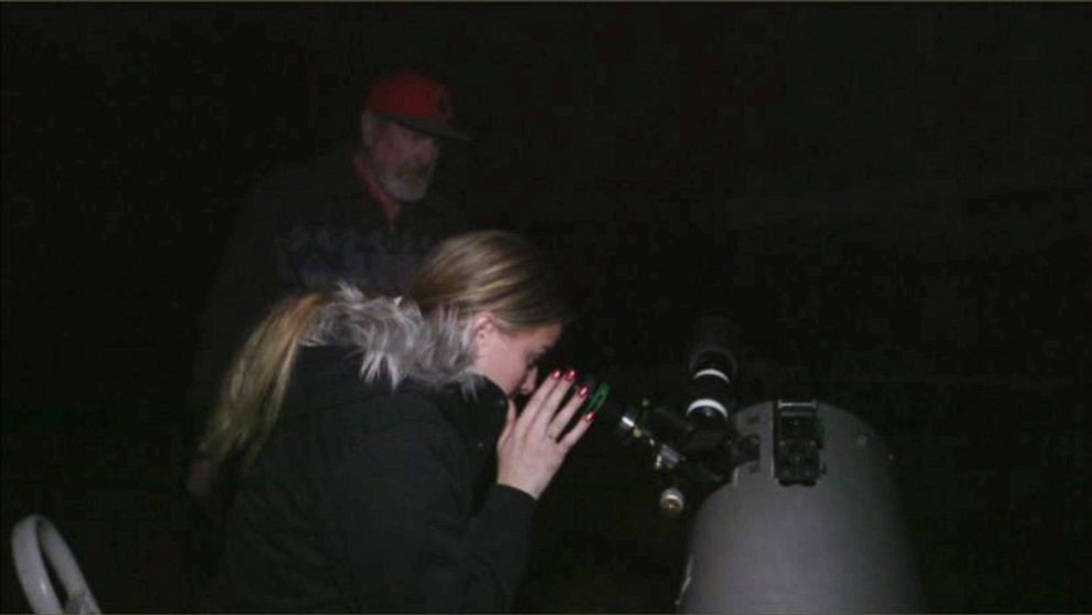 PHOTO: Heather Hodlin sees stars for the first time while peering through a telescope in February 2019.