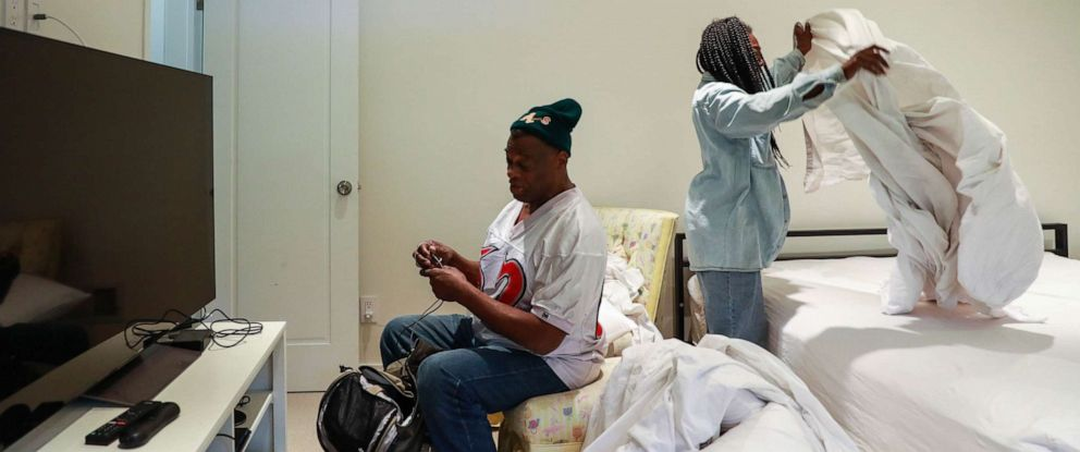 PHOTO: Greg Dunston, Sr. converses with partner Marie Mckinzie as she makes up their bed in Piedmont, Calif., April 18, 2019.