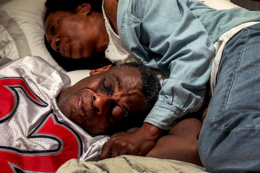 PHOTO: Marie Mckinzie, 54, and her partner, Greg Dunston, Sr., rest in bed inside the basement apartment where theyve been living since February, in Piedmont, Calif., on April 18, 2019.