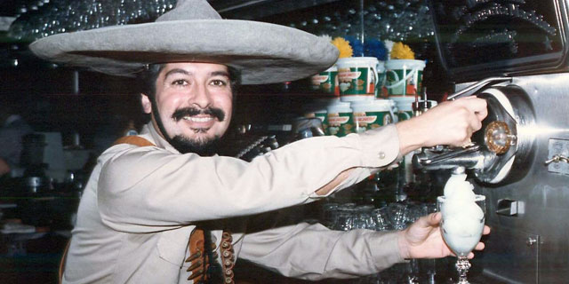 PHOTO: Mariano Martinez prepares the perfect frozen margarita.