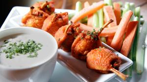 PHOTO Chef Josh Capon?s patented Lollipop Chicken are shown.